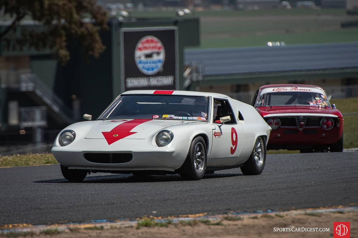 A Lotus Europa being chased through Turn 2 by an Alfa Romeo at Sonoma Raceway